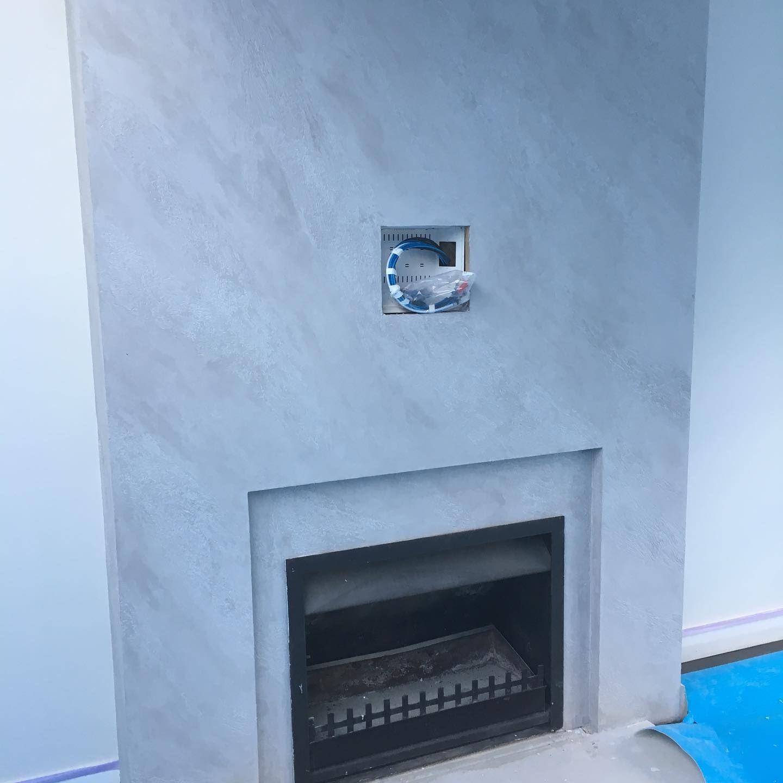 venetian plastered fireplace